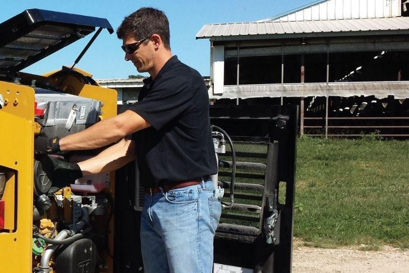 difference between a skid steer and tractor